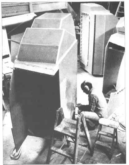 Sanding modular head units before insertion into the hull. Carolyn Latteier Photo 1986